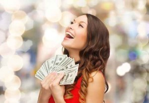 pretty woman holding fanned money cropped